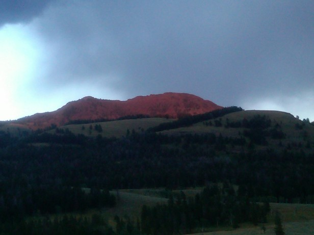 Sunset torning rocks orange in Yellowstone