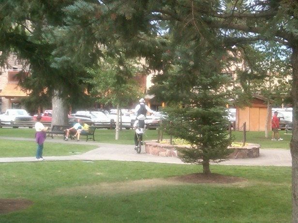 Juggler atop Cycler's shoulders in Park