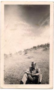 Uncle Dwight sitting in field during war